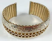 Julio gold tone cuff bracelet, bas relief flowers and filigree front over mesh back, 1940s-50s