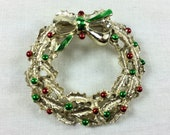 Vintage Gerry's Christmas wreath brooch, light gold tone holly leaves with red and green berries, gold and green bow, signed