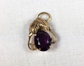 "Tru-Kay 12K gold fill and ""amethyst"" glass pendant with leaves"