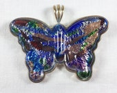 Heavy multicolor molded glass butterfly pendant with silver tone back