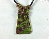 Kenneth Cole KC green and purple enamel pendant on leather cord with adjustable length clasp