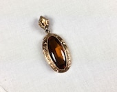 Late Victorian low karat gold and topaz glass hand engraved pendant
