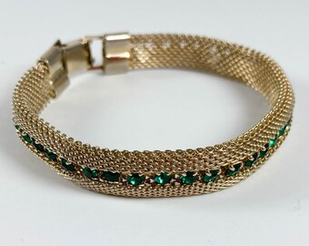 "Vintage gold tone mesh bracelet with emerald green rhinestones, 1950s, 7.25"""