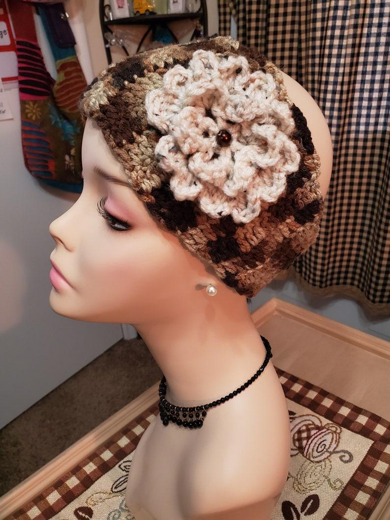Ear warmer detachable flower adjustable Winter Spring or fall.