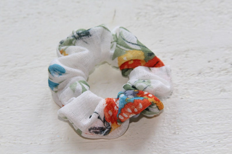 white and floral scrunchie