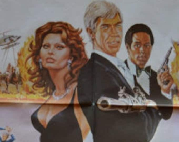 Original poster pack and press guide from the film: Power of Fire (1979) with James Coburn and Sofia Loren.