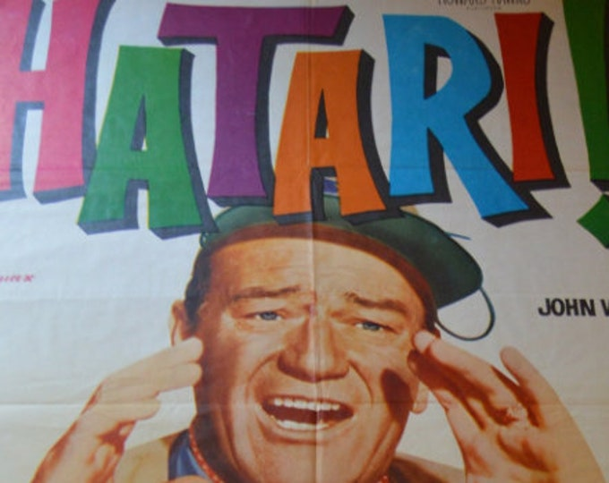Hatari( 1962) by Howard Hawks with John Wayne . Original cinema poster of the premiere in Spain.