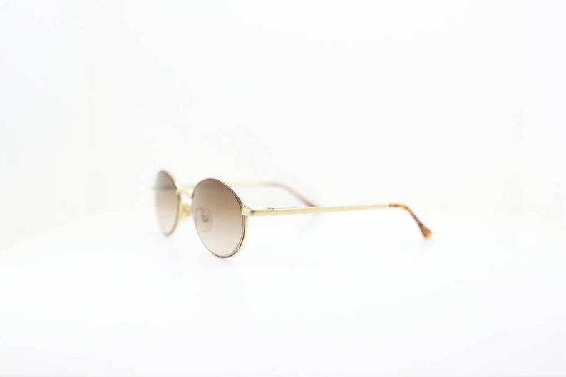 Vintage sunglasses, Round sunglasses, Gianni seulini,  Women sunglasses, New old stock