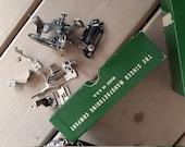 Singer class 301 sewing machine metal feet parts ruffler etc and booklet manual