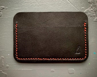 Minimalist card holder, three pockets, black leather with red stitching
