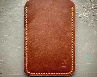 Minimalist three-pocket, two-tone brown, wallet with orange stitching