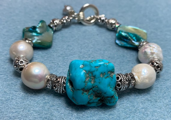 Turquoise pearl and silver statement bracelet