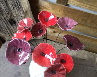 10 small red poppies, dark reds and plums in cermal wire