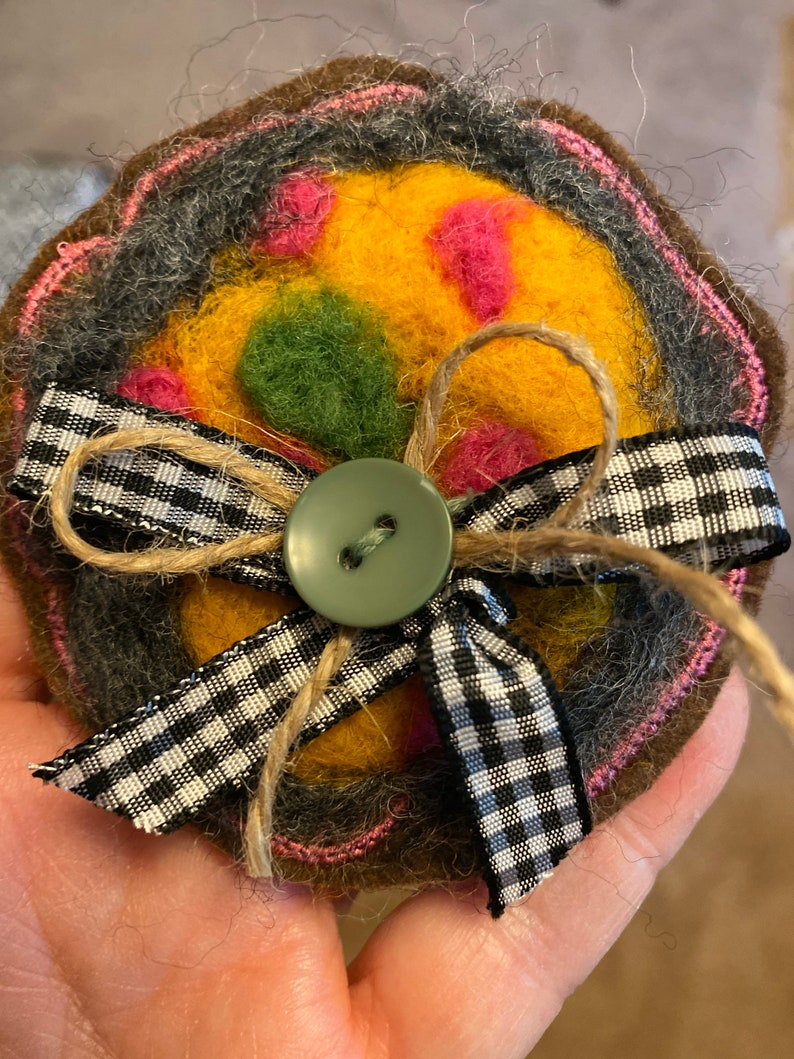 Needle felted pin with silver button and ribbon
