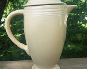 Vintage Homer Laughlin Fiesta Ivory Coffeepot. This fiestaware coffee server with the old original hlc mark does have a chip on the lid.