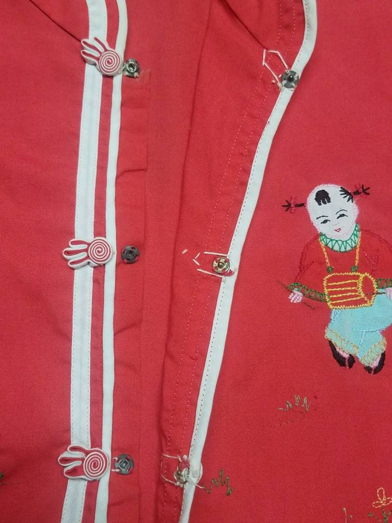 Cheongsam Qipao Chipao Vintage childs Chinese dress up shirt It features a embroidered boy and girl on the front Daffodil  Size 14 kids