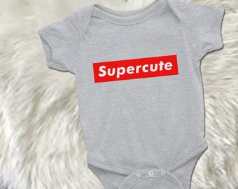 e3f61cfdcd50 Supreme Baby Bodysuit Designer Inspired Onesie in White Black Heather Gray  or Pink One Piece for Infant or Toddler Baby Shower Gift