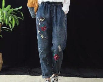Vintage blue jeans with floral embroidery