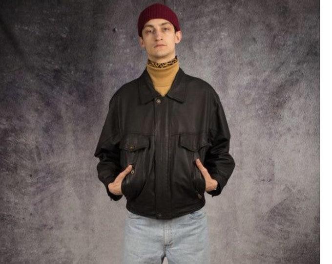 Old school 90s dark gray real leather grunge men's biker jacket for retro look lovers
