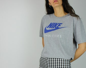 8c79c1c9 Vintage Nike Sports Tshirt Top with Logo Front