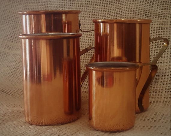 Discover your inner Julia Child with these Mid Century Copper measuring cups