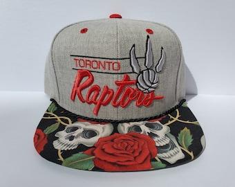 517ac556083 NBA Toronto Raptors Custom Snapback: Rose Skulls #1