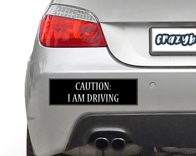 Caution I Am Driving 10 x 3 Bumper Sticker - Custom changes and orders welcomed!