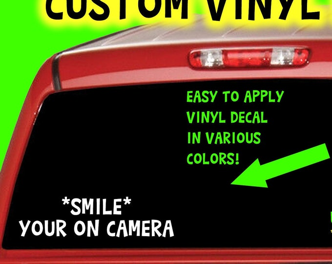 Smile your on camera in Color Vinyl Various Sizes and Colors Die Cut Vinyl Decal also in Cool Chrome Colors!