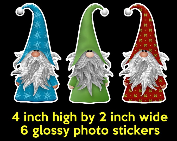 6+ assorted quantities available of our large christmas knome stickers 4 inches high by 2 inches wide glossy vivid stickers