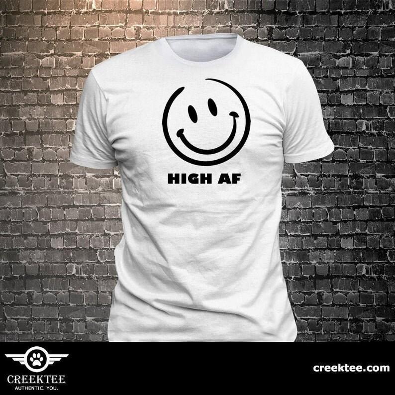 CAD$29.99 - Happy Face Smiling emoji HIGH AF T-shirt   Gift Fun - Funny t-shirt, fun tshirt, Customize your t-shirt... Ask us!