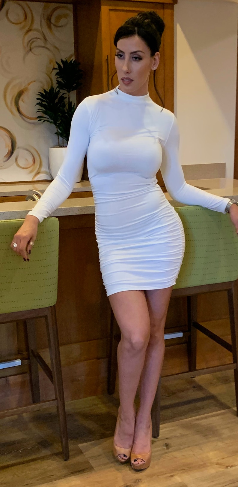 Women Fashion Elegant Bodycon Dress with long sleeves and drawstring design on the back.