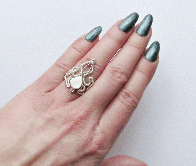 Ice Queen ring adjustable wire wrapped ring with mother of image 0