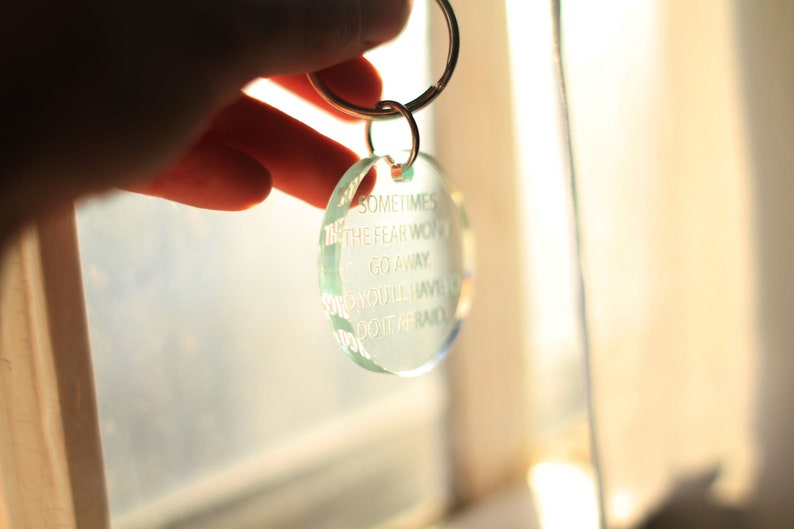 sometimes the fear won/'t go away so you/'ll have to do it afraid quote Handcrafted laser cut clear glass green acrylic keychain