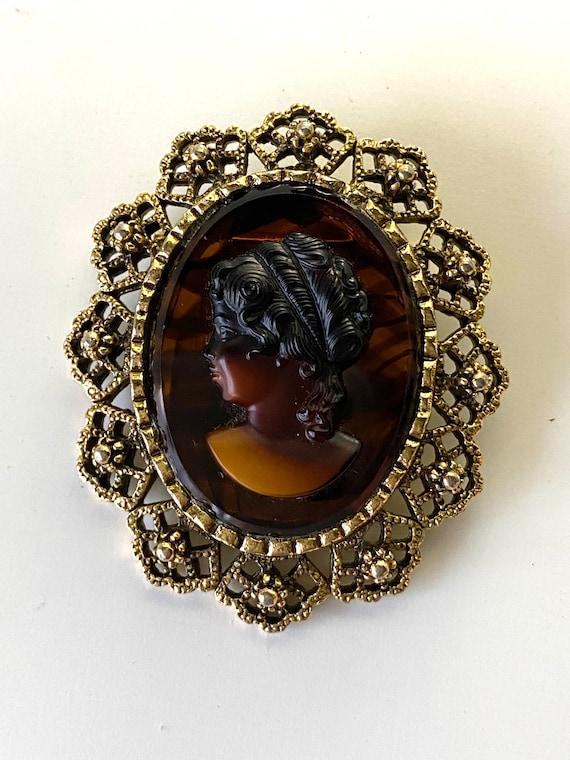 Fabulous Vintage large gold metal amber glass openwork brooch