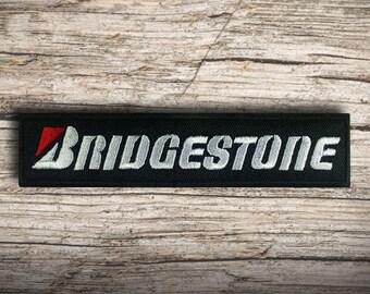 7,1x6,8cm Bridgestone Logo Racing Reifen Bügelbild schwarz Aufnäher