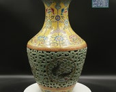 Qing Dynasty Famille-Rose double wall vase with jumping fish leads the Chinese