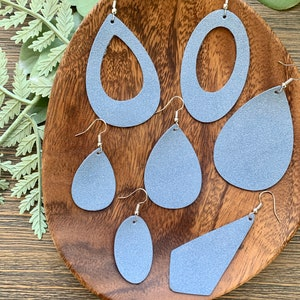 White backgroundshiny blue polka dot leather earrings lightweight jewelry gifts for her
