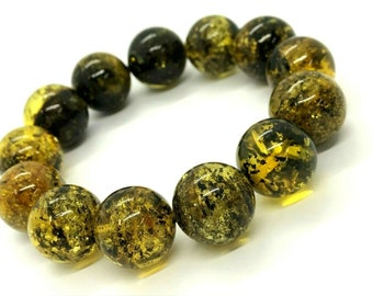 Exclusive 61.80 grams Greenish Glittering Natural Genuine BALTIC AMBER Stretch Bracelet on elastic string