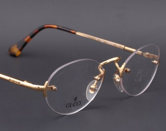 908d8c49a8d Gucci GG 1243/N vintage rimless eyeglasses / oval glasses frames by Gucci  made in Italy 90's