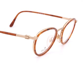 7d7ee1b7d01b Gucci GG 1329 clasy vintage eyeglasses with pantos shape and tortoise frames,  made in Italy 90's