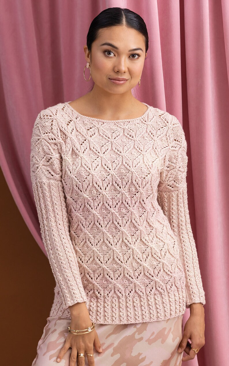 Textural pink pastel pullover sweater with a delicate geometric pattern