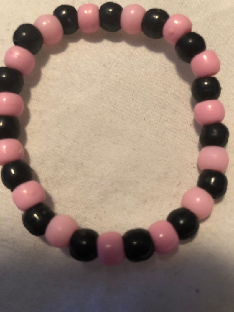 Handmade black and pink beaded bracelet