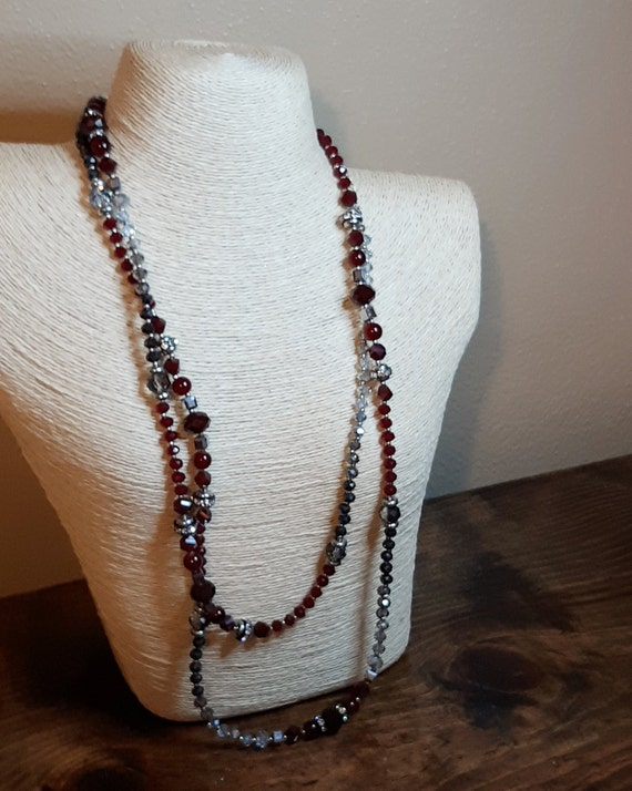 Vintage White House Black Market with red grey and translucent beads silver tone accent and rhinestone accents  53 inches long