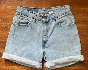 0c71353f 90's Vintage Women's Levi's 550 High Waist Denim Shorts