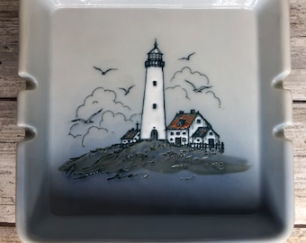 Vintage Man Hobo Look with Cigar standing by Lighthouse  Man on Ashtray