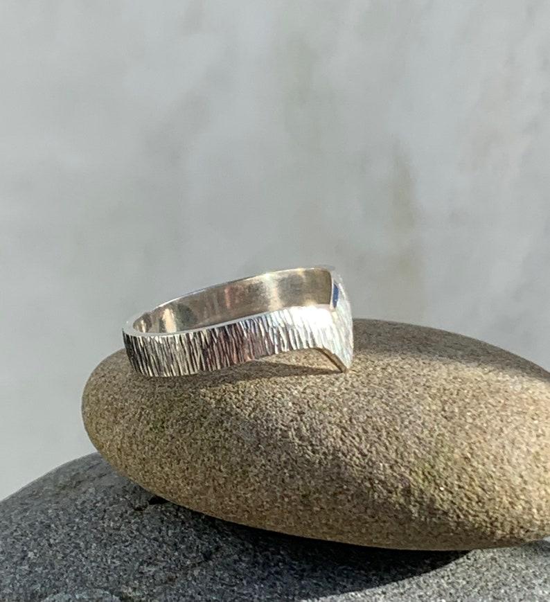 Silver V shaped patterned ring