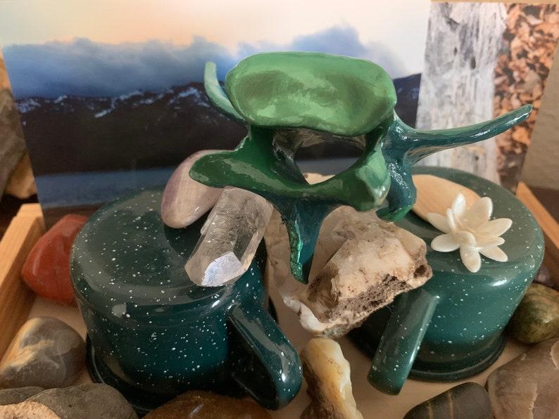 hand-painted with enamel in teal and iridescent green Painted deer vertebrae \u201cMermaid Tail\u201d Thoracic vertebrae from a deer