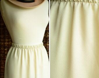 Caron high waist eighties pastel yellow skirt | vintage 80s pale yellow skirt, size 6