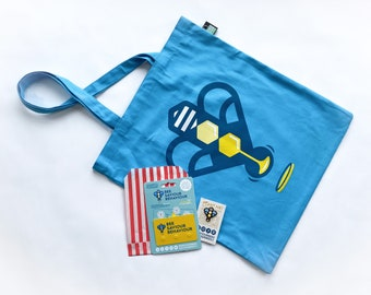 A Bee Saviour Card, enamel badge and a heavy cotton tote bag with pocket
