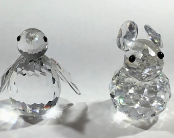 Swarovski Crystal retired dolphin, duck, cat and rabbit in wonderful condition.